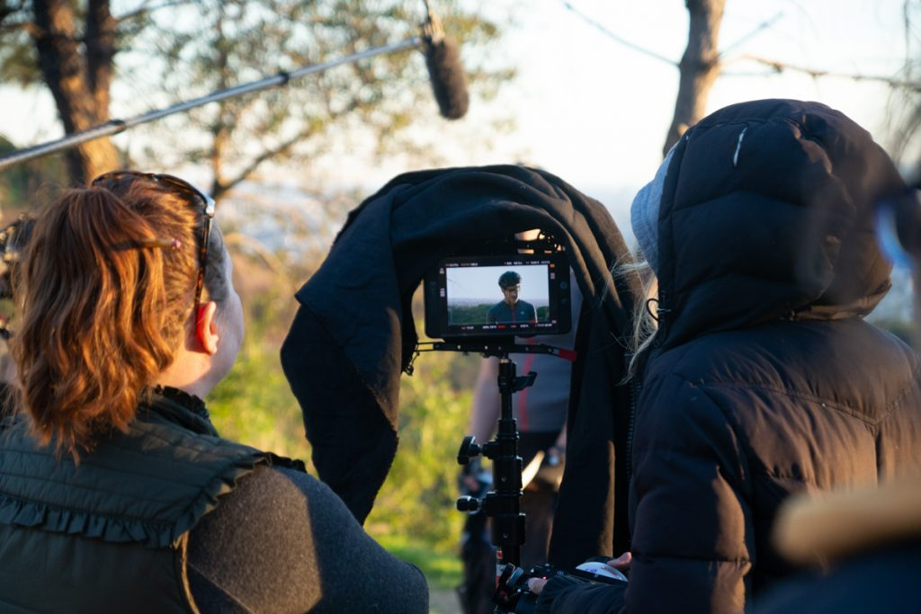 Behind the scenes photo of Director Jen McGowan and Second Assistant Camera Julia Pasternak on set.