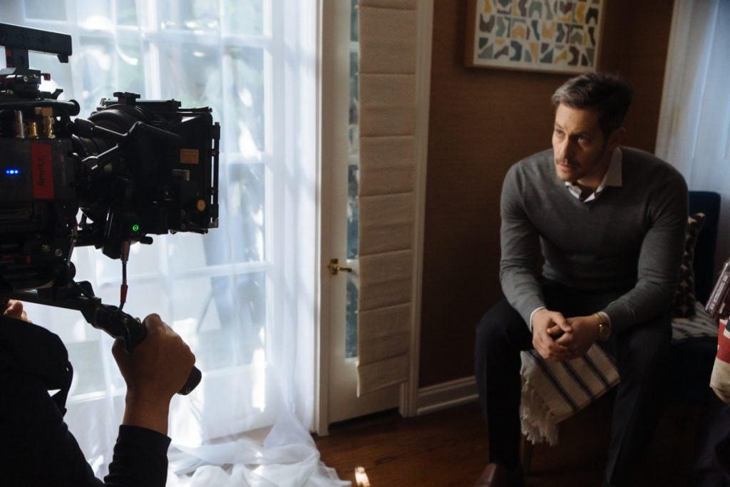 Close up of actor Jeremy Glazer playing Scott Long